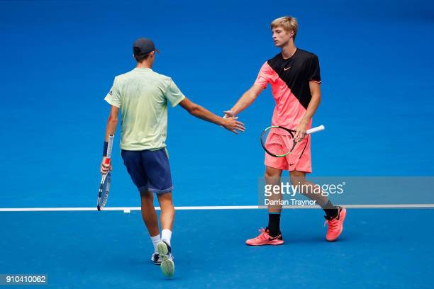 Henri Squire of Germany and Rudolf Molleker of Germany talk tactics in the boy's doubles final against Hugo Gaston of France and Clement Tabur of...