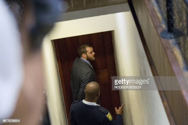 Henri Van Breda is led out of the Western Cape High Court in Cape Town on June 5 to hear the sentence in his trial for the alleged killing of his two...