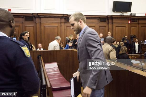 Henri Van Breda leaves the Western Cape High Court in Cape Town on June 5 to hear the sentence in his trial for the alleged killing of his two...