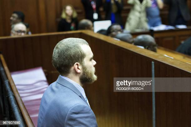 Henri Van Breda sits in the dock at the Western Cape High Court in Cape Town on June 5 to hear the sentence in his trial for the alleged killing of...