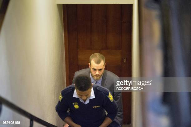 Henri Van Breda walks towards the Western Cape High Court in Cape Town on June 5 to hear the sentence in his trial for the alleged killing of his two...