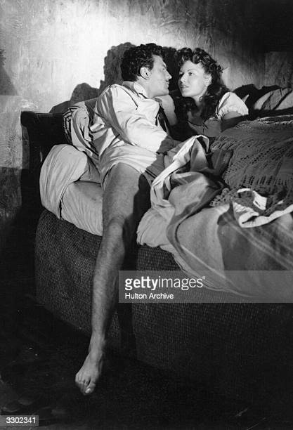 Henri Vidal and Claudine Dupuis in bed in a scene from 'Gluttony' in the composite film 'Les Septs Peches Capitaux directed by Carlo Rim for Franco...