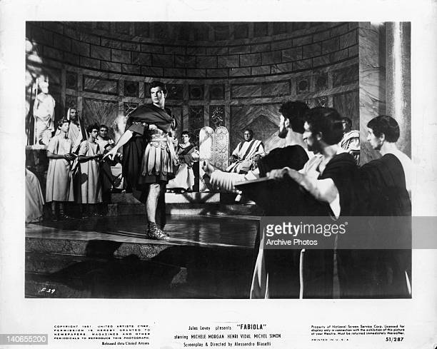 Henri Vidal is the center of attention in a scene from the film 'Fabiola' 1949