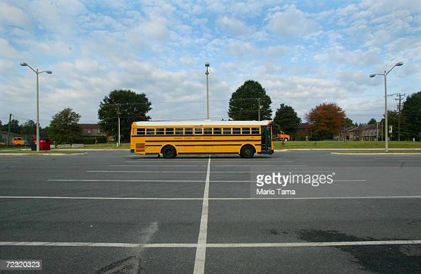 Henrico County school bus sits in the empty Henrico High School parking lot October 22 2002 in Richmond Virginia All Richmond area schools were...