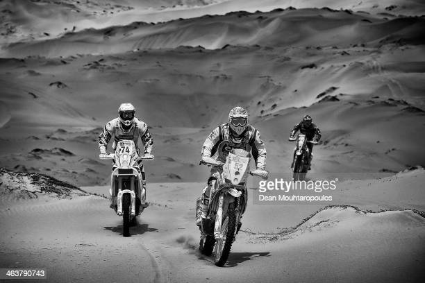 Henricus Vogels of the Netherlands for KTM Bas Dakar Team, Claudio Rodriguez of Chile for Tamarugal Honda Racing XC Rally Team and Robert Van Pelt...