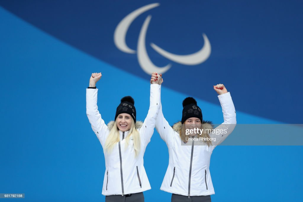 Henrieta Farkasova (R) of Slovakia and her guide Natalia Subrtova celebrate their Gold medal during the medal ceremony for Women's Giant Slalom during day five of the PyeongChang 2018 Paralympic Games on March 14, 2018 in Pyeongchang-gun, South Korea.