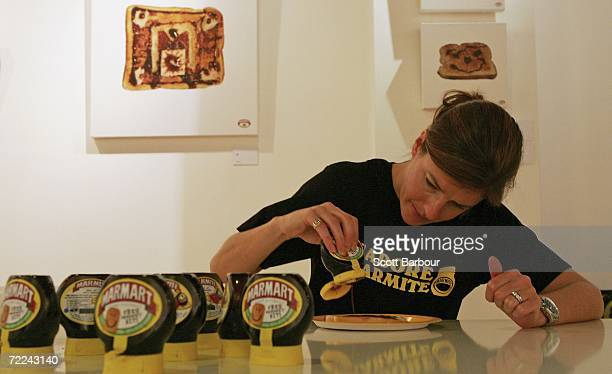 Henrietta Birchenough squeezes a tube of Marmite onto a piece of toast during the Marmart exhibition at the Air Gallery on October 23 2006 in London...