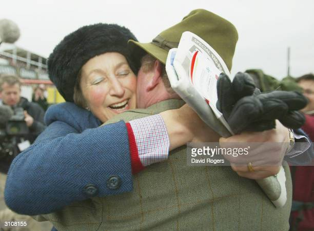Henrietta Knight the trainer of Best Mate hugs her partner Terry Biddlecombe after the Totesport Cheltenham Gold Cup held on the third day of the...