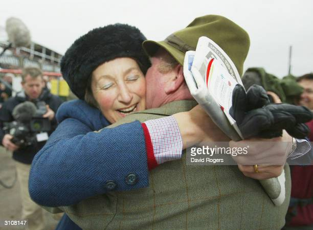 Henrietta Knight the trainer of Best Mate runs to her partner Terry Biddlecombe after the Totesport Cheltenham Gold Cup held on the third day of the...
