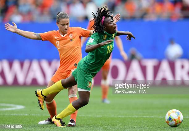 Henriette Akaba of Cameroon is challenged by Sherida Spitse of the Netherlands during the 2019 FIFA Women's World Cup France group E match between...