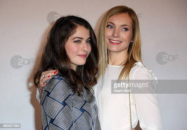 Henriette Confurius and Nadja Uhl arrive for the premiere of 'Tannbach Schicksal eines Dorfes' at Sony Center on December 16 2014 in Berlin Germany