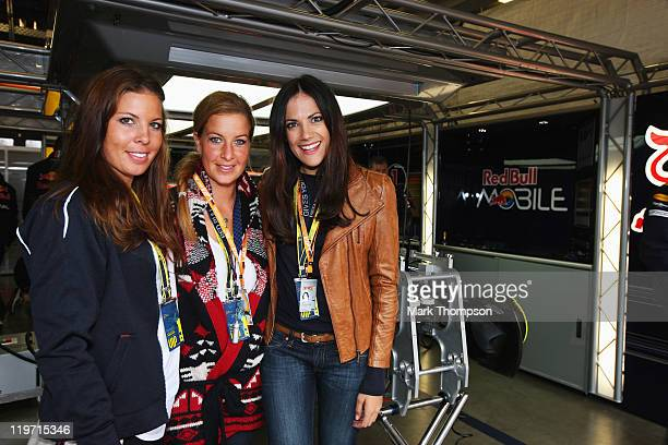 Henriette Engelhardt, Charlotte Engelhardt and Bettina Zimmerman are seen in the Red Bull Racing garage before the German Formula One Grand Prix at...