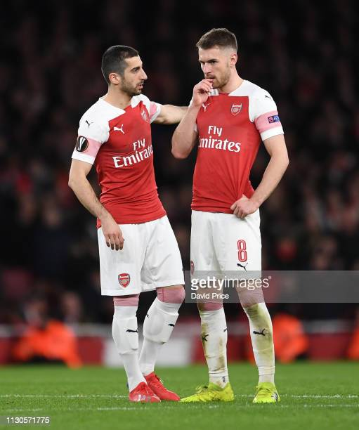 Henrihk Mkhitaryan and Aaron Ramsey of Arsenal talk during the UEFA Europa League Round of 16 Second Leg match between Arsenal and Stade Rennais at...