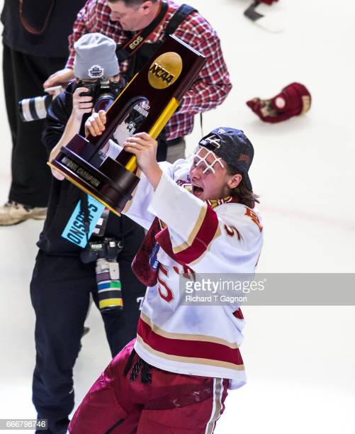 Henrik Borgstrom of the Denver Pioneers celebrates a victory against the Minnesota Duluth Bulldogs by raising the championship trophy after the 2017...