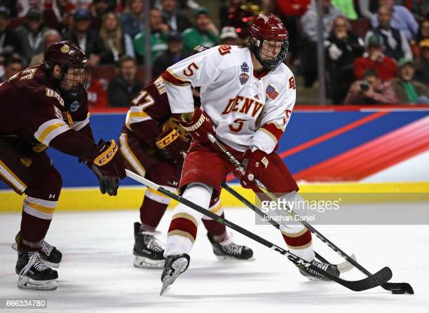 Henrik Borgstrom of the Denver Pioneers is pressure by Nick Wolff of the MinnesotaDuluth Bulldogs during the 2017 NCAA Division I Men's Ice Hockey...