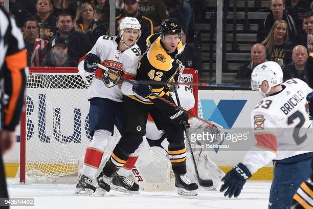 Henrik Borgstrom of the Florida Panthers against David Backes of the Boston Bruins at the TD Garden on April 8 2018 in Boston Massachusetts