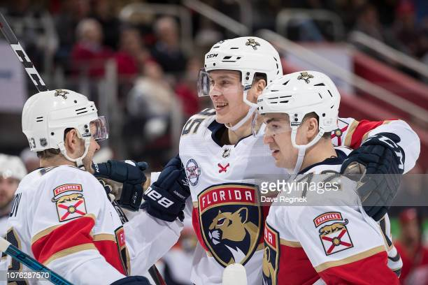 Henrik Borgstrom of the Florida Panthers celebrates his second period goal with teammates Frank Vatrano and Evgenii Dadonov during an NHL game...