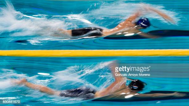 Henrik Christiansen from Noorwegen and Maarten Brzoskowski from The Netherlands compete during the Men's 1500m Freestyle Final of the FINA/airweave...