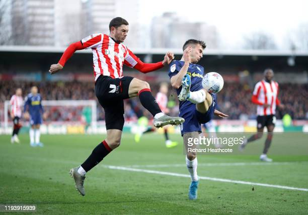 Henrik Dalsgaard of Brentford is tackled by Joe Bryan of Fulham during the Sky Bet Championship match between Brentford and Fulham at Griffin Park on...