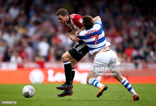 Henrik Dalsgaard of Brentford tackles with Luke Freeman of QPR during the Sky Bet Championship match between Brentford and Queens Park Rangers at...