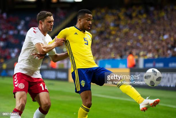 Henrik Dalsgaard of Denmark and Martin Olsson of Sweden competes for the ball during the International Friendly match between Sweden and Denmark at...