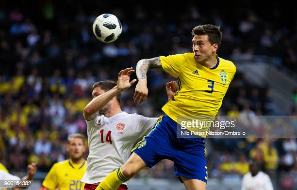 Henrik Dalsgaard of Denmark and Victor Nilsson Lindelof of Sweden competes for the ball during the International Friendly match between Sweden and...