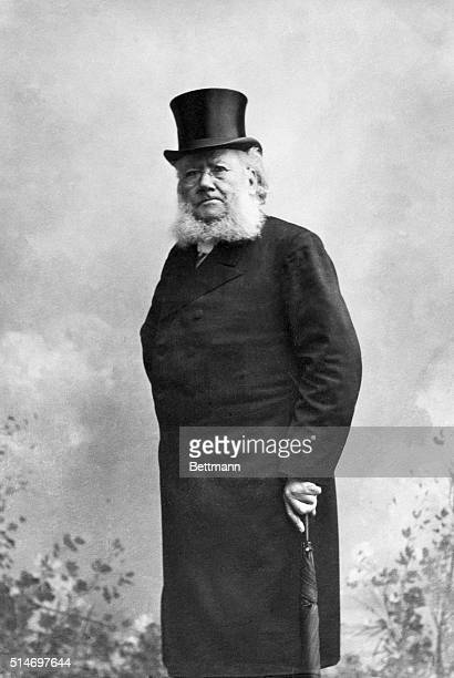 Henrik Ibsen, Swedish playwright, waist up, with bowler hat and cane. SEE NOTE