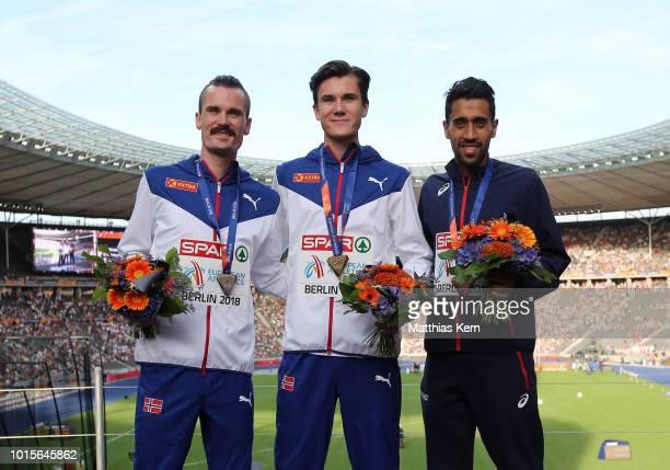 Henrik Ingebrigtsen of Norway silver Jakob Ingebrigtsen of Norway gold and Morhad Amdouni of France bronze pose with their medals for the Men's 5000...