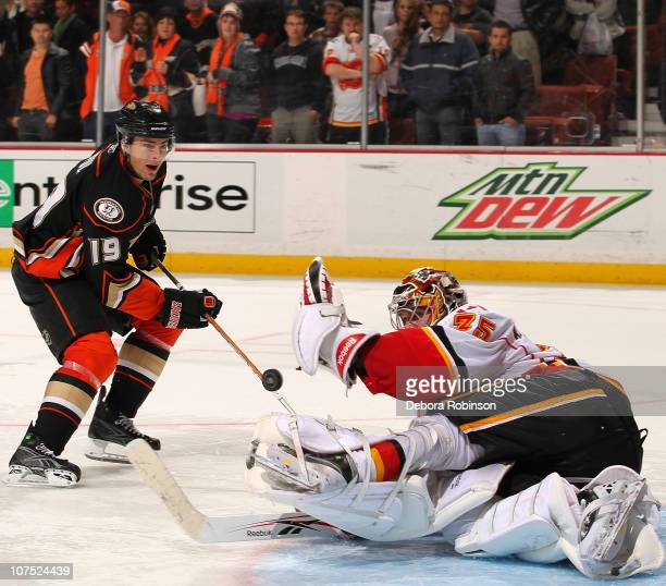 Henrik Karlsson of the Calgary Flames stops a shot on goal in a shootout from Joffrey Lupul of the Anaheim Ducks during the game on December 10 2010...