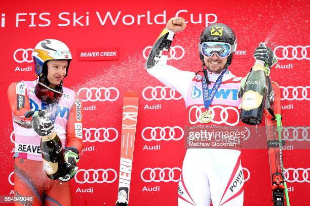 Henrik Kristoffersen of Norway and Marcel Hirscher of Austria celebrate on the medals podium after the Men's Giant Slalom during the Audi Birds of...