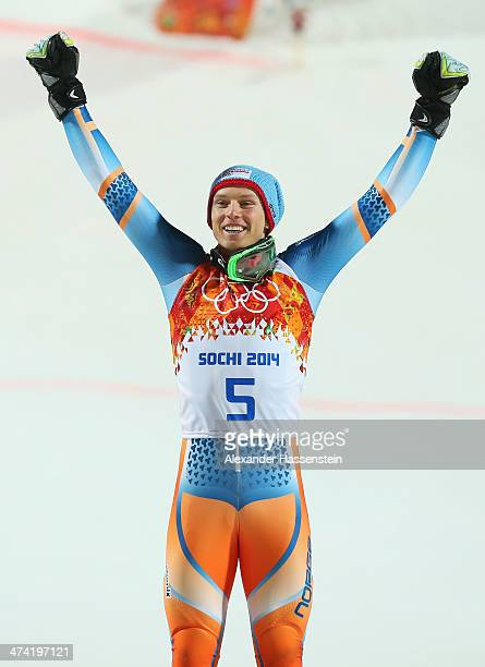 Henrik Kristoffersen of Norway celebrates on the podium before being awarded his bronze medal during the medal ceremony for the Men's Slalom during...