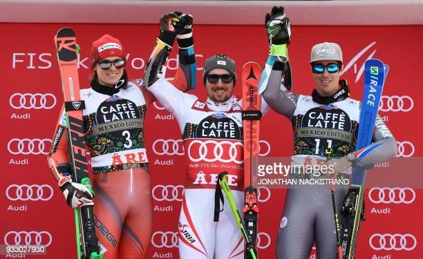 Henrik Kristoffersen of Norway Marcel Hirscher of Austria and Victor MuffatJeandet of France pose on the podium after the Men's Giant Slalom event of...
