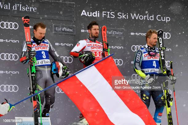 Henrik Kristoffersen of Norway takes 2nd place Marcel Hirscher of Austria takes 1st place Matts Olsson of Sweden takes 3rd place during the Audi FIS...
