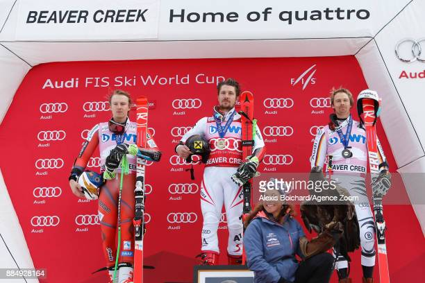 Henrik Kristoffersen of Norway takes 2nd place Marcel Hirscher of Austria takes 1st place Stefan Luitz of Germany takes 3rd place during the Audi FIS...