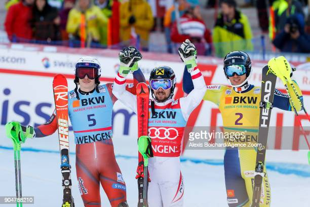 Henrik Kristoffersen of Norway takes 2nd place Marcel Hirscher of Austria takes 1st place Andre Myhrer of Sweden takes 3rd place during the Audi FIS...