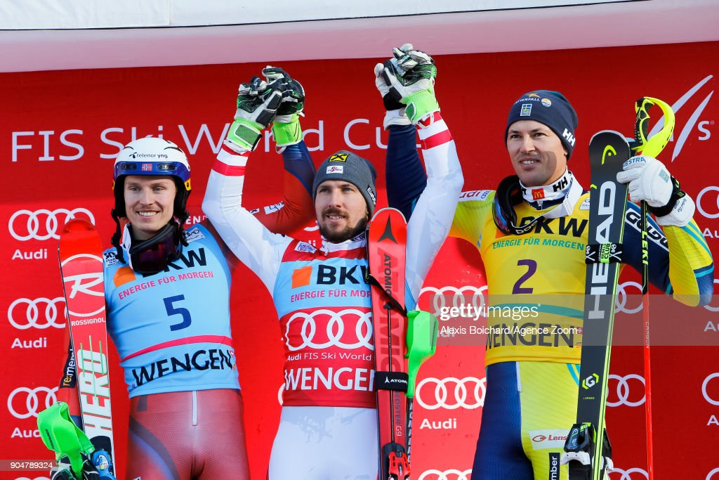 Henrik Kristoffersen of Norway takes 2nd place, Marcel Hirscher of Austria takes 1st place, Andre Myhrer of Sweden takes joint 3rd place during the Audi FIS Alpine Ski World Cup Men's Slalom on January 14, 2018 in Wengen, Switzerland.