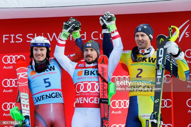 Henrik Kristoffersen of Norway takes 2nd place Marcel Hirscher of Austria takes 1st place Andre Myhrer of Sweden takes joint 3rd place during the...