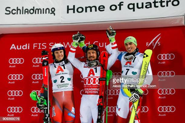 Henrik Kristoffersen of Norway takes 2nd place Marcel Hirscher of Austria takes 1st place Daniel Yule of Switzerland takes 3rd place during the Audi...