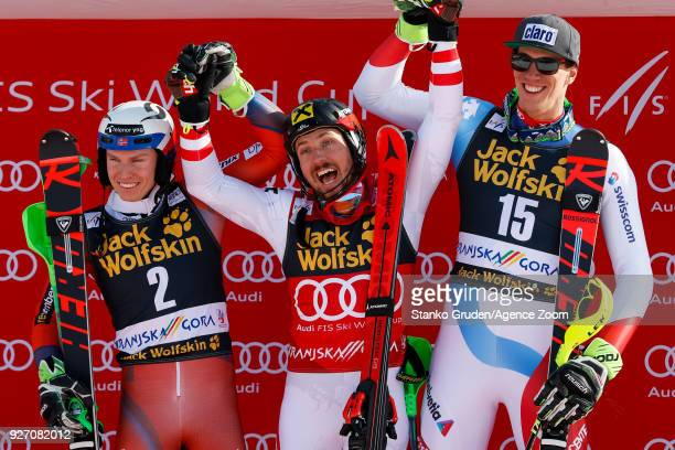 Henrik Kristoffersen of Norway takes 2nd place Marcel Hirscher of Austria takes 1st place Ramon Zenhaeusern of Switzerland takes 3rd place during the...