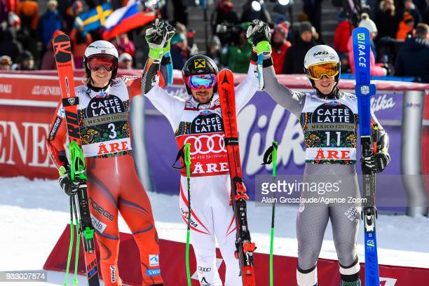 Henrik Kristoffersen of Norway takes 2nd place Marcel Hirscher of Austria takes 1st place Victor Muffatjeandet of France takes 3rd place during the...