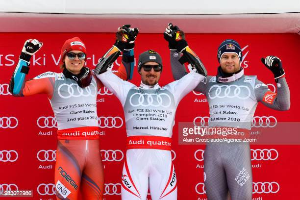 Henrik Kristoffersen of Norway takes 2nd place Marcel Hirscher of Austria wins the globe Alexis Pinturault of France takes 3rd place during the Audi...