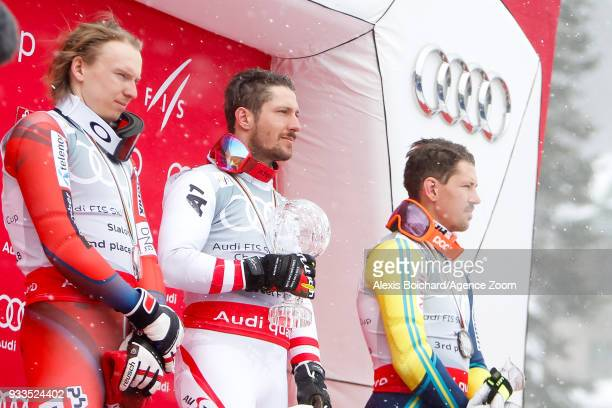 Henrik Kristoffersen of Norway takes 2nd place Marcel Hirscher of Austria wins the globe Andre Myhrer of Sweden takes 3rd place during the Audi FIS...