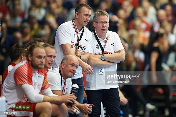 Henrik Kronborg assistant coach of Denmark and Gudmundur Gudmundsson head coach of Denmark looks on from the bench during the World Championship...