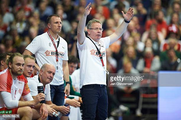 Henrik Kronborg assistant coach of Denmark and Gudmundur Gudmundsson head coach of Denmark giving instructions from the bench during the World...