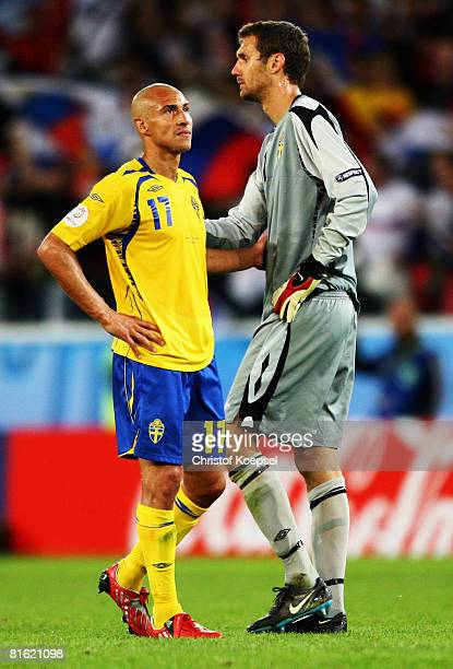 Henrik Larsson and goalkeeper Andreas Isaksson of Sweden look dejected after defeat in the UEFA EURO 2008 Group D match between Russia and Sweden at...