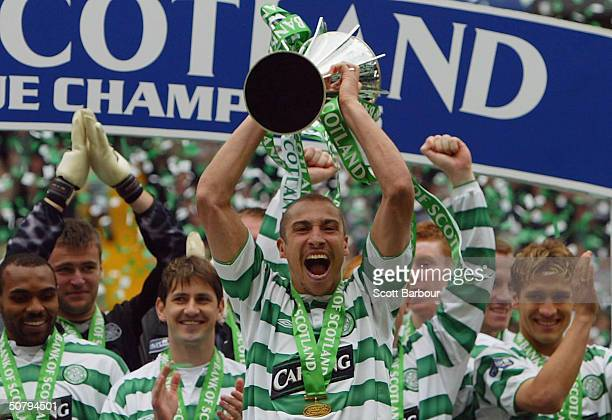 Henrik Larsson and his Celtic team mates celebrate after being presented with the Scottish Premier League Trophy after the Scottish Premier League...