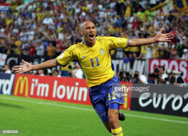 Henrik Larsson celebrates scoring his first goal during the UEFA Euro 2004 Group C match between Sweden and Bulgaria at the Estadio Jose Alvalade on...