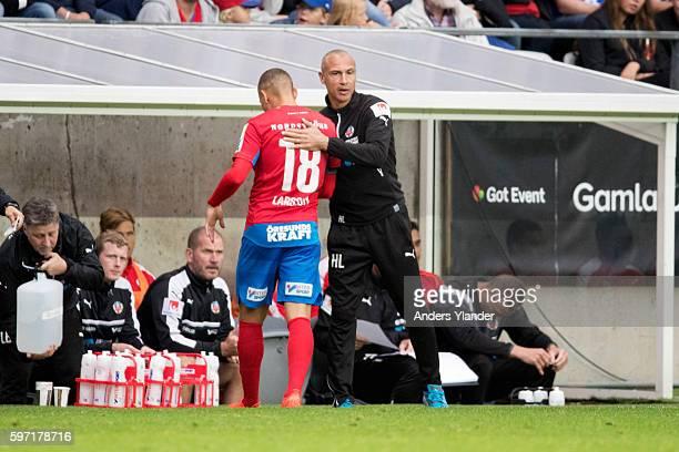 Henrik Larsson head coach of Helsingborgs IF hug Jordan Larsson of Helsingborgs IF during the Allsvenskan match between IFK Goteborg and Helsingborgs...