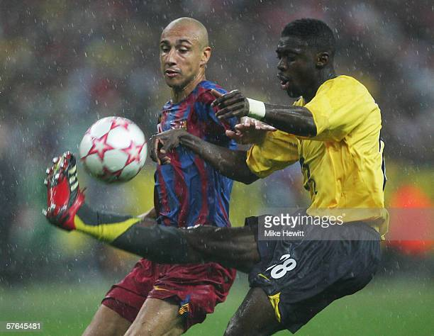 Henrik Larsson of Barcelona is foiled by Kolo Toure of Arsenal during the UEFA Champions League Final between Arsenal and Barcelona at the Stade de...