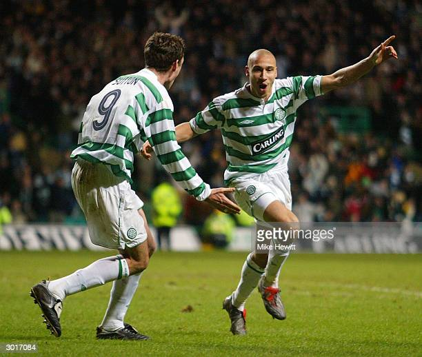 Henrik Larsson of Celtic celebrates his second goal with teammate Chris Sutton during the UEFA Cup match between Celtic and FK Teplice at Celtic Park...